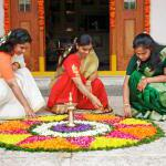 Women decorating a pookalam